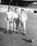 1931 - Harold Moe (left), Coach Paul Schissler, John Biancone (right)