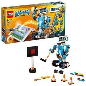 caja y componentes de Lego Boost con un robot y diversos accesorios robots para niños desde 7 años