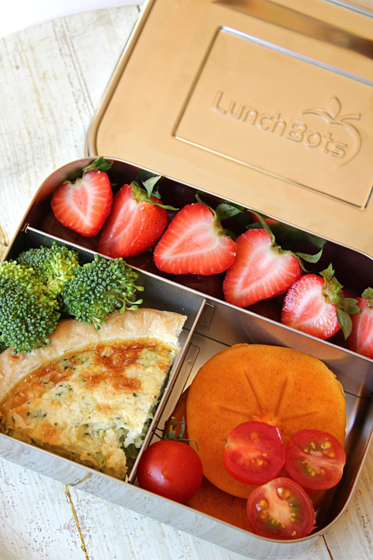 Kids Bento Box Lunch Ideas: Quiche, grapes, strawberries, persimmon, broccoli, cherry tomato