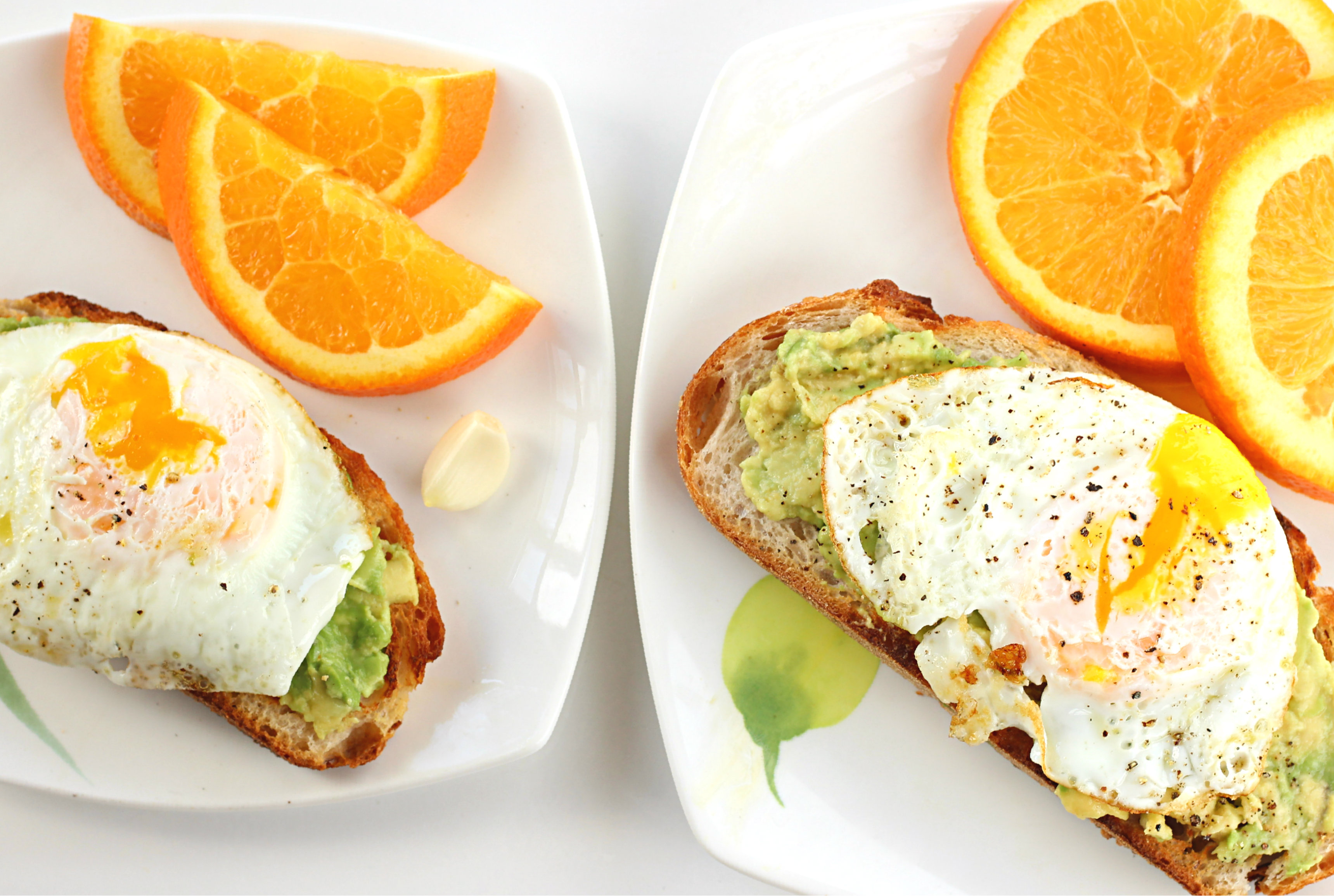 Avocado toast with garlic and over easy egg.