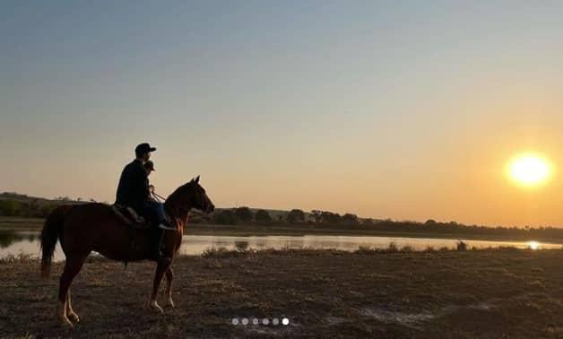 Sandy showing his son on horseback