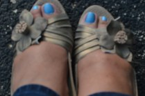 Open toe shoes and bright colored nails