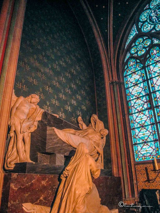 statue of a saint in notre dame cathedral paris france