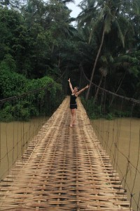 Swinging on the Bamboo bridge near Batukaras, Java