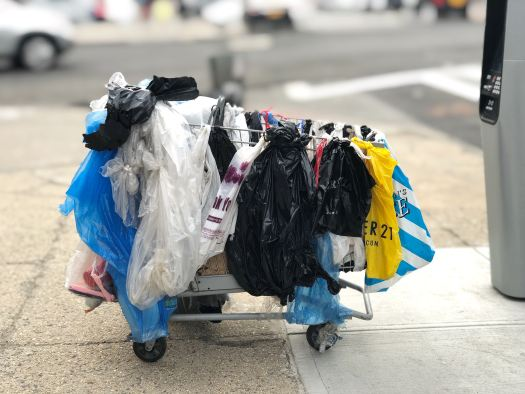 plastic bag collection on cart, Photo by Lance Grandahl on Unsplash