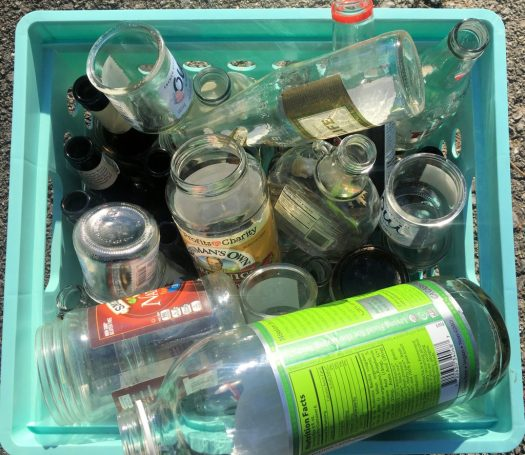 One of several bins of glass I brought to recycle, as I collect from two households. Photo by me.