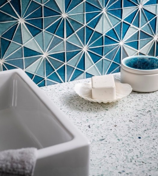 Recycled glass countertops and backsplash by Vetrazzo, a recycled glass surface company in California. How gorgeous!