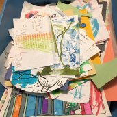 Photos of bins of my son's art pieces.