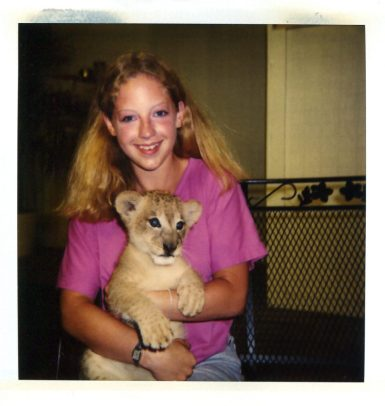 Author holding a baby lion.