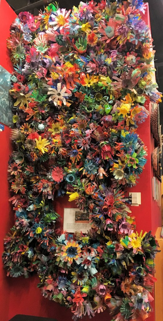Wall of flowers created from colorful plastic bottles at the Creative Discovery Museum.