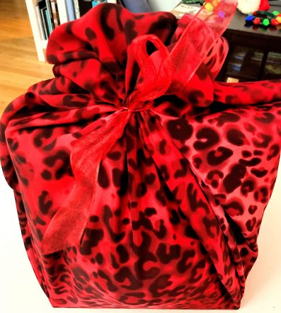 Fabric wrapped gift, red leopard print