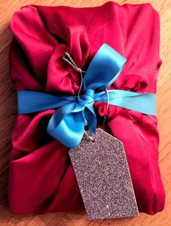Fabric wrapped gift, pink satin