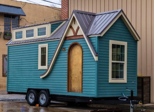 Blue tiny house with rounded door