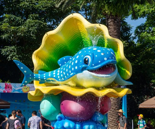 Cartoon sculpture of a whale with fountain at Chimelong Ocean Kingdom