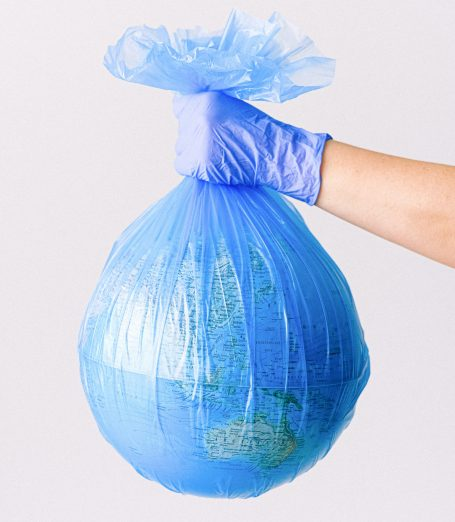 Earth globe in a blue plastic bag