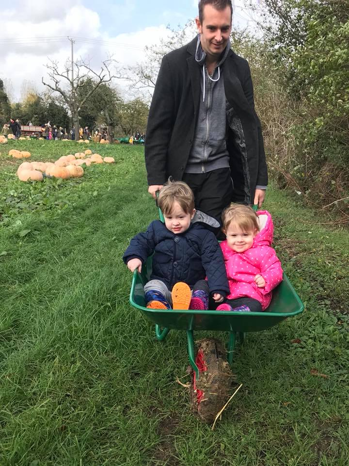 Toddlers riding in wheelbarrow