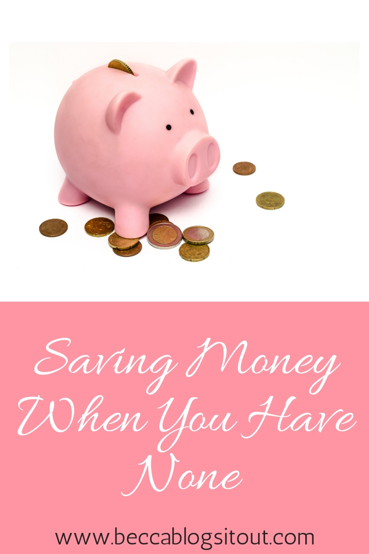 Saving Money When You Have None - image of a pink piggy bank with pennies scattered around it