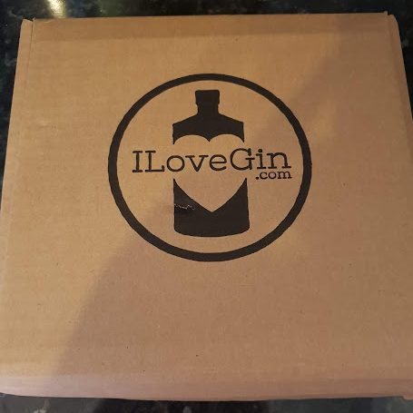 cardboard box with ILoveGin.com logo on the front