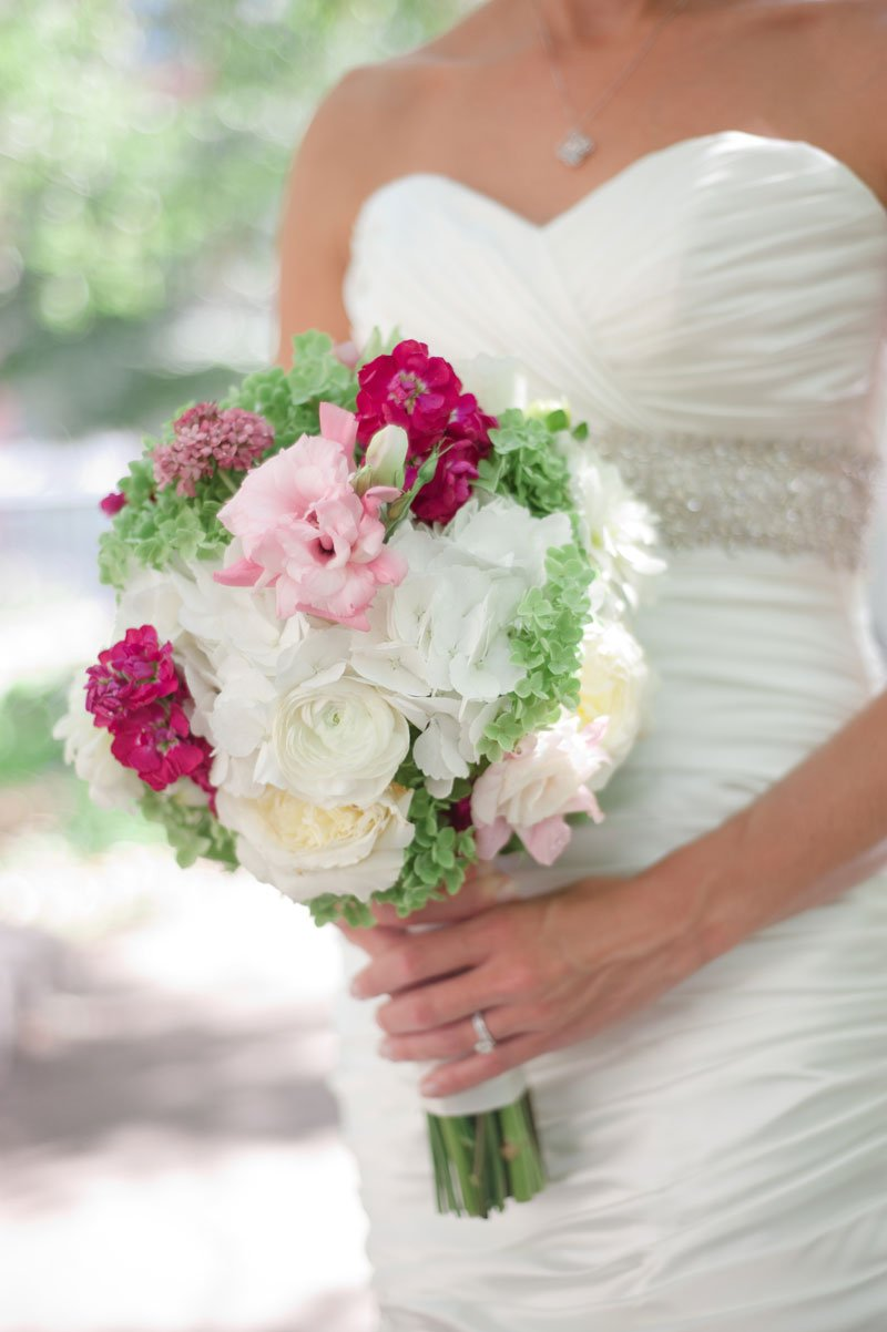 details of wedding bouquet with pink, hot pink, green, and white flowers