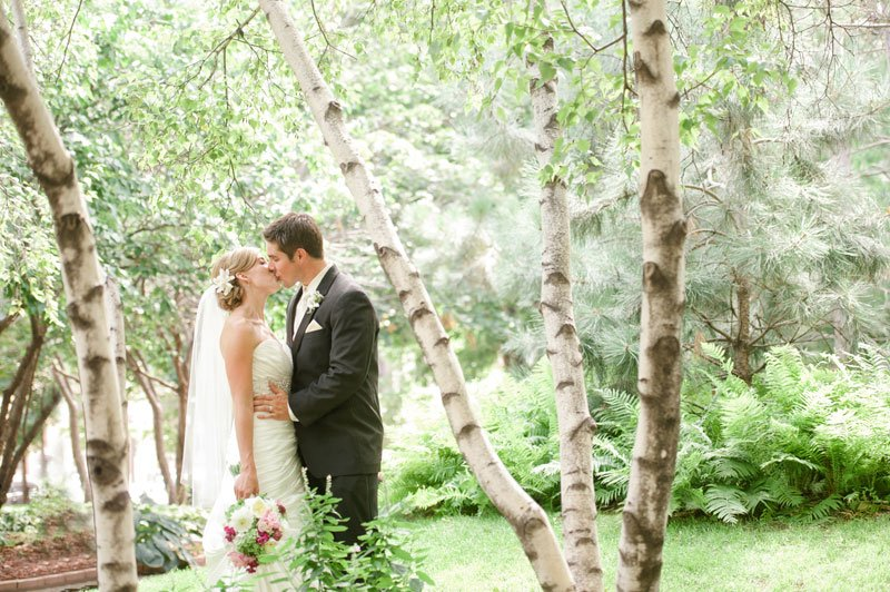 bride and groom kiss amid the birch trees at Mears Park, St Paul