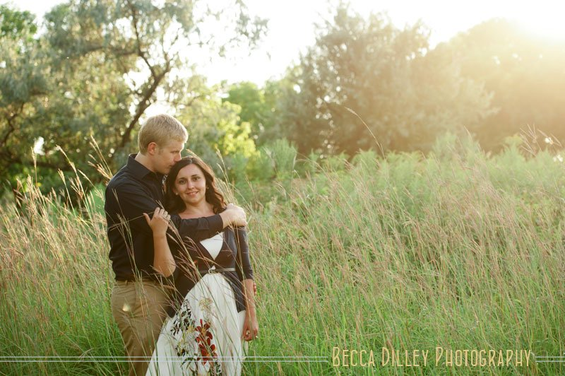minneapolis summer engagement photos hugging in tall grass