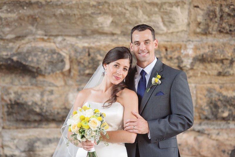 bride and groom at stone arch bridge