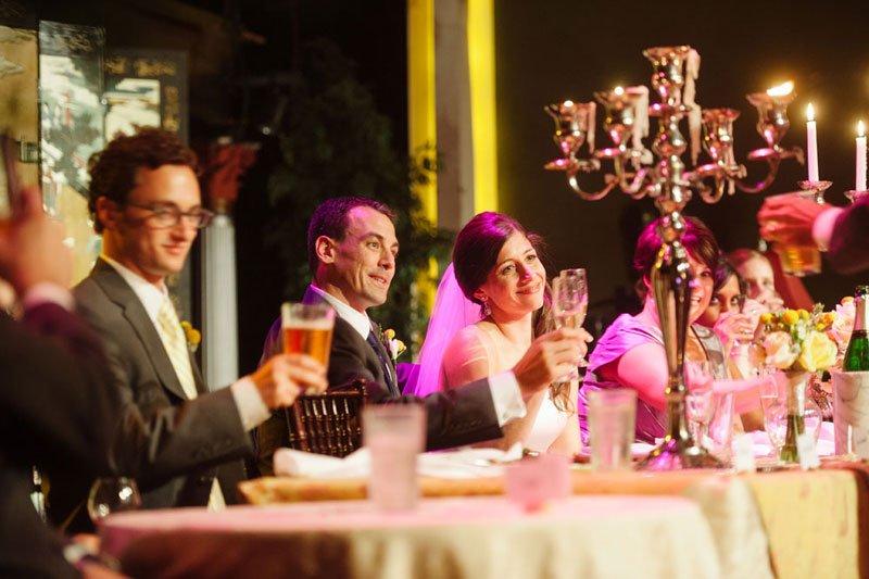 bride and groom listen to speeches at varsity theater wedding minneapolis