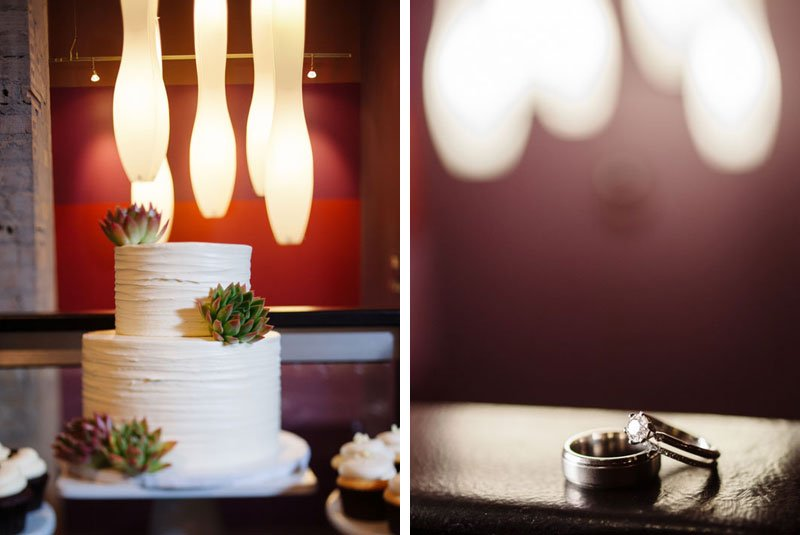 close up of cake and wedding rings with architectural lighting five event center minneapolis wedding