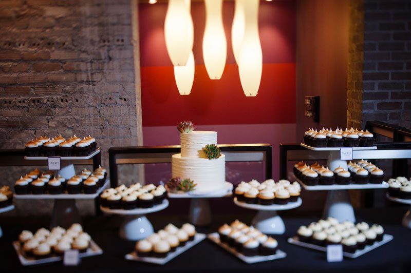 wedding cake table with architectural lighting five event center minneapolis wedding