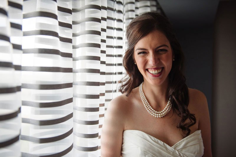 minneapolis wedding photographer bride in front of black and white stripe background