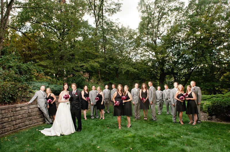minneapolis wedding photographer flash composite of bride and groom with 8 bridesmaids and 8 groomsmen - large wedding party dramatic portrait