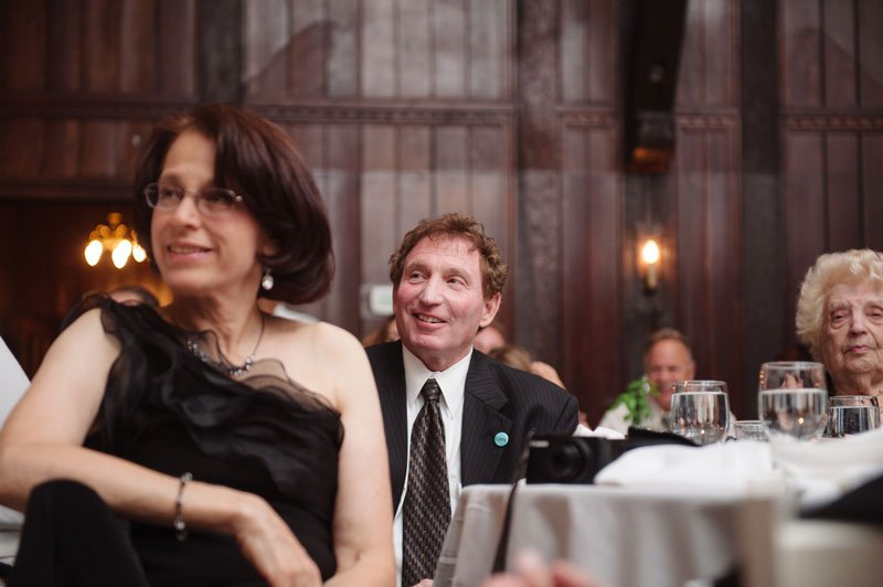 bride's family listens to speeches at Theadore Wirth Park Chalet Minneapolis