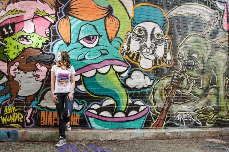 urban minneapolis senior photo with mural