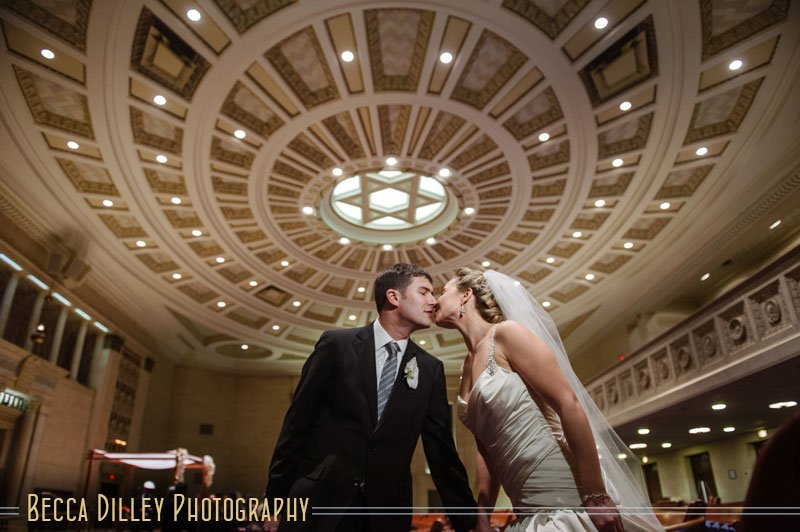 Bride and groom under Star of David ceiling at Temple Israel Minneapolis