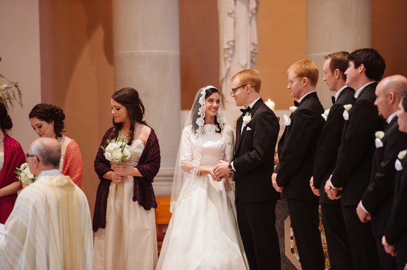 bride and groom laugh during ceremony at st thomas church wedding st paul mn