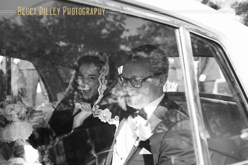 bride and groom in back of vintage car st thomas church wedding st paul mn