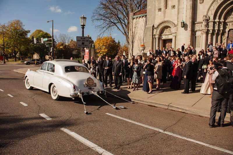 bride and groom exit in vintage car st thomas church wedding st paul mn