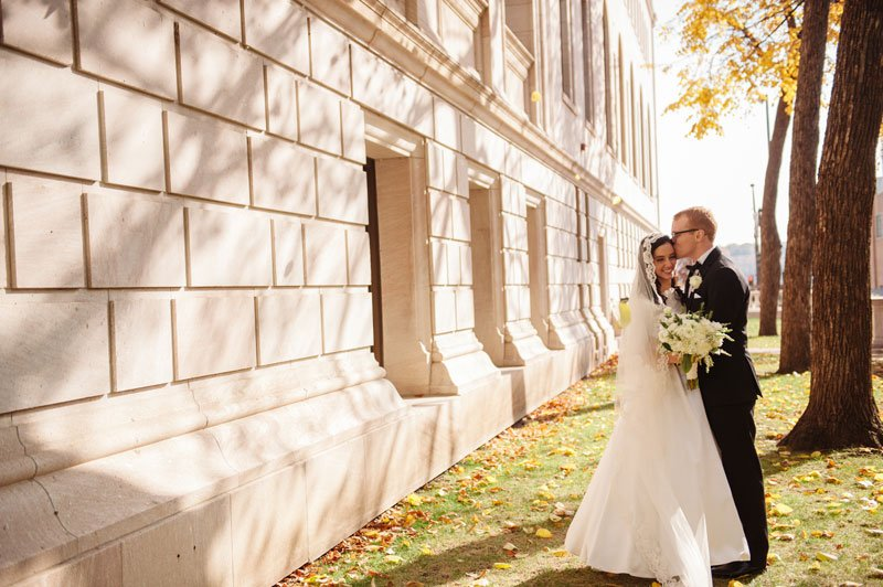 st paul mn wedding at jj hill library groom kisses bride on cheek wearing vintage gown