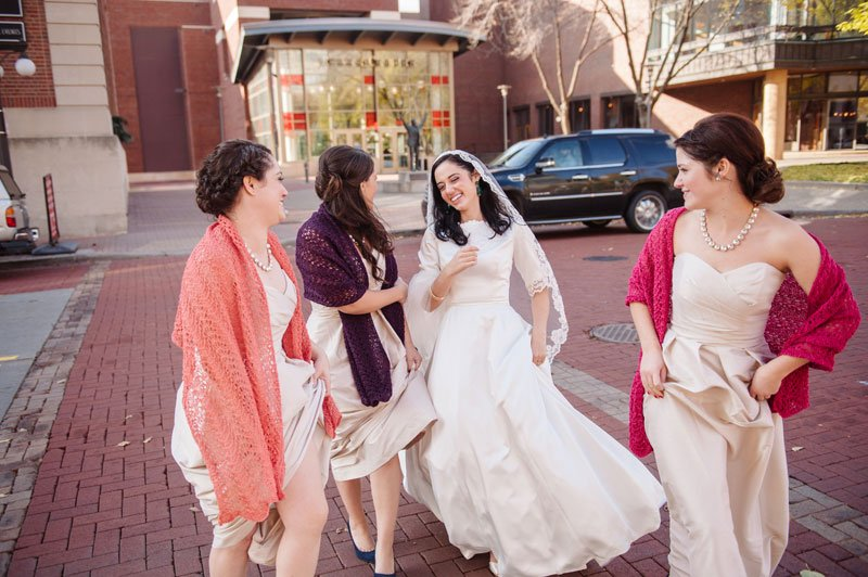 st paul mn wedding at jj hill library bride with sisters walk across street