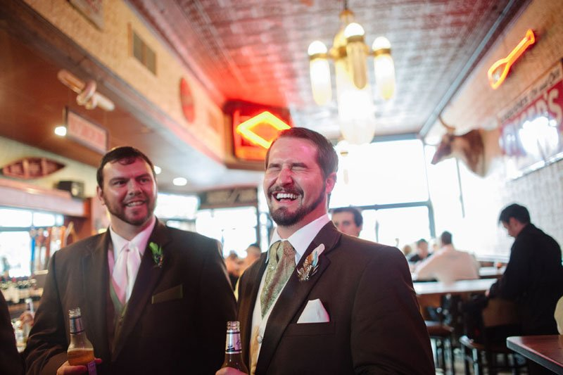 groom laughs at stillwater mn bar after wedding
