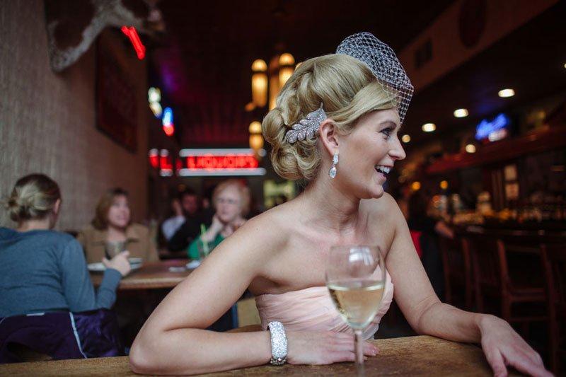 bride in stillwater dive bar after wedding mn