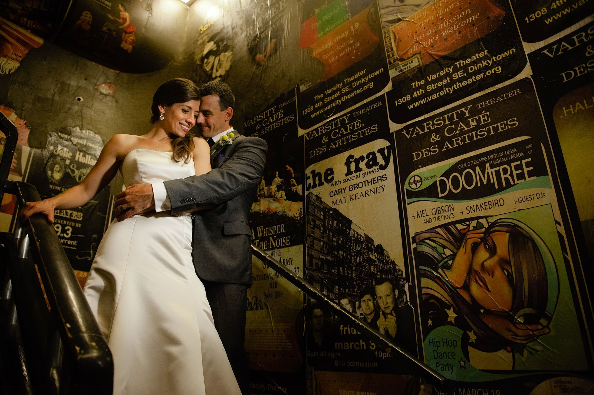Varsity theater wedding photography couple on stairs by music posters