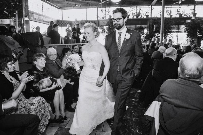 bride and groom walk down aisle at loring pasta bar wedding minneapolis