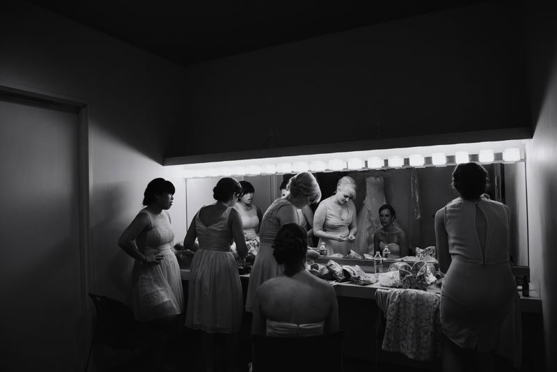 bridesmaids getting ready at Guthrie theater before wedding minneapolis