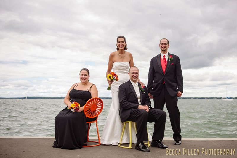 wedding party on terrace chairs before memorial union wedding madison wi