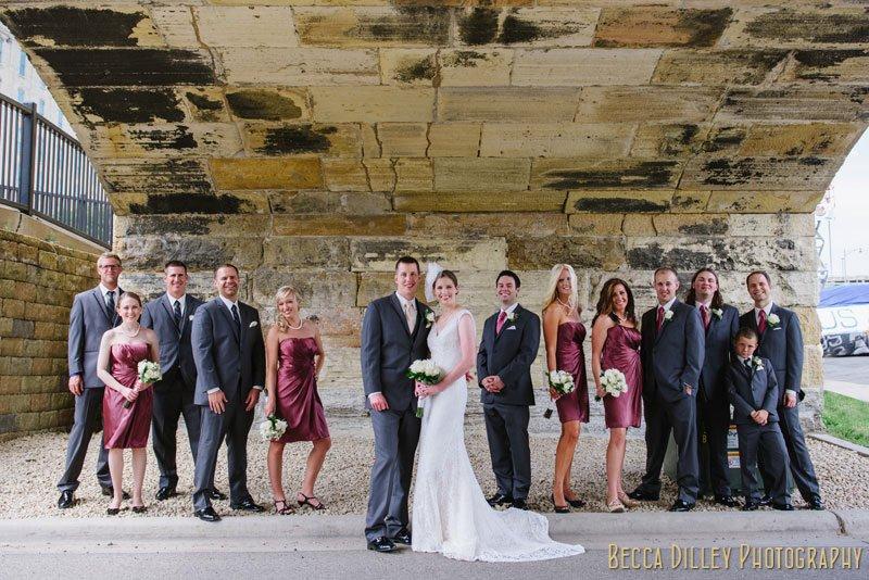 wedding party under stone arch bridge