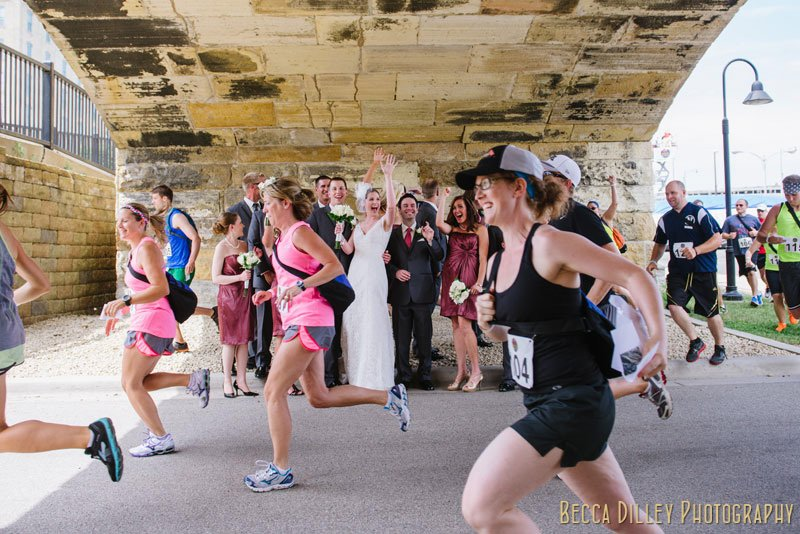 runners past wedding party