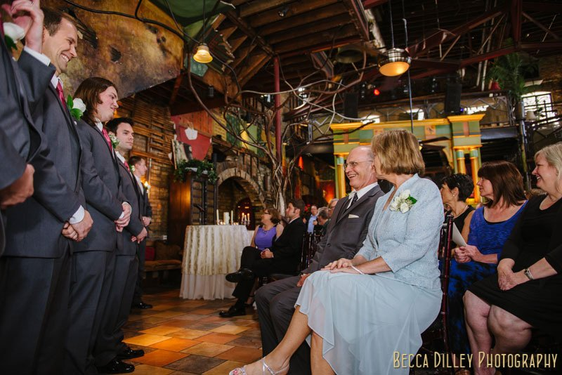grooms parents look on for loring pasta bar minneapolis wedding