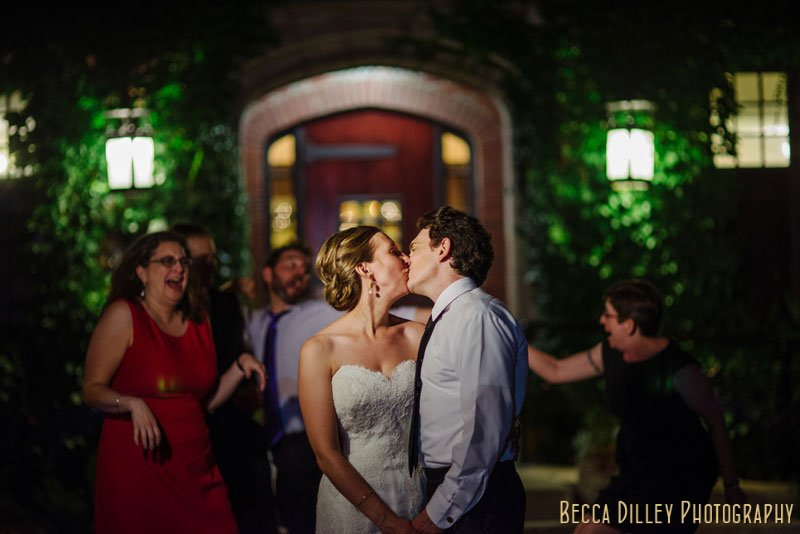 bride and groom outside st paul university club at night