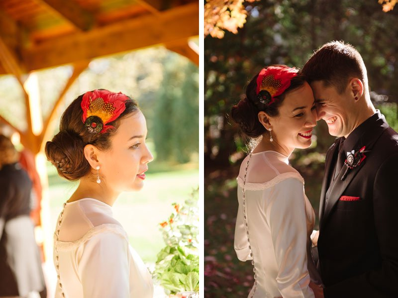 bride wears grandmothers wedding gown and red fascinator in hair